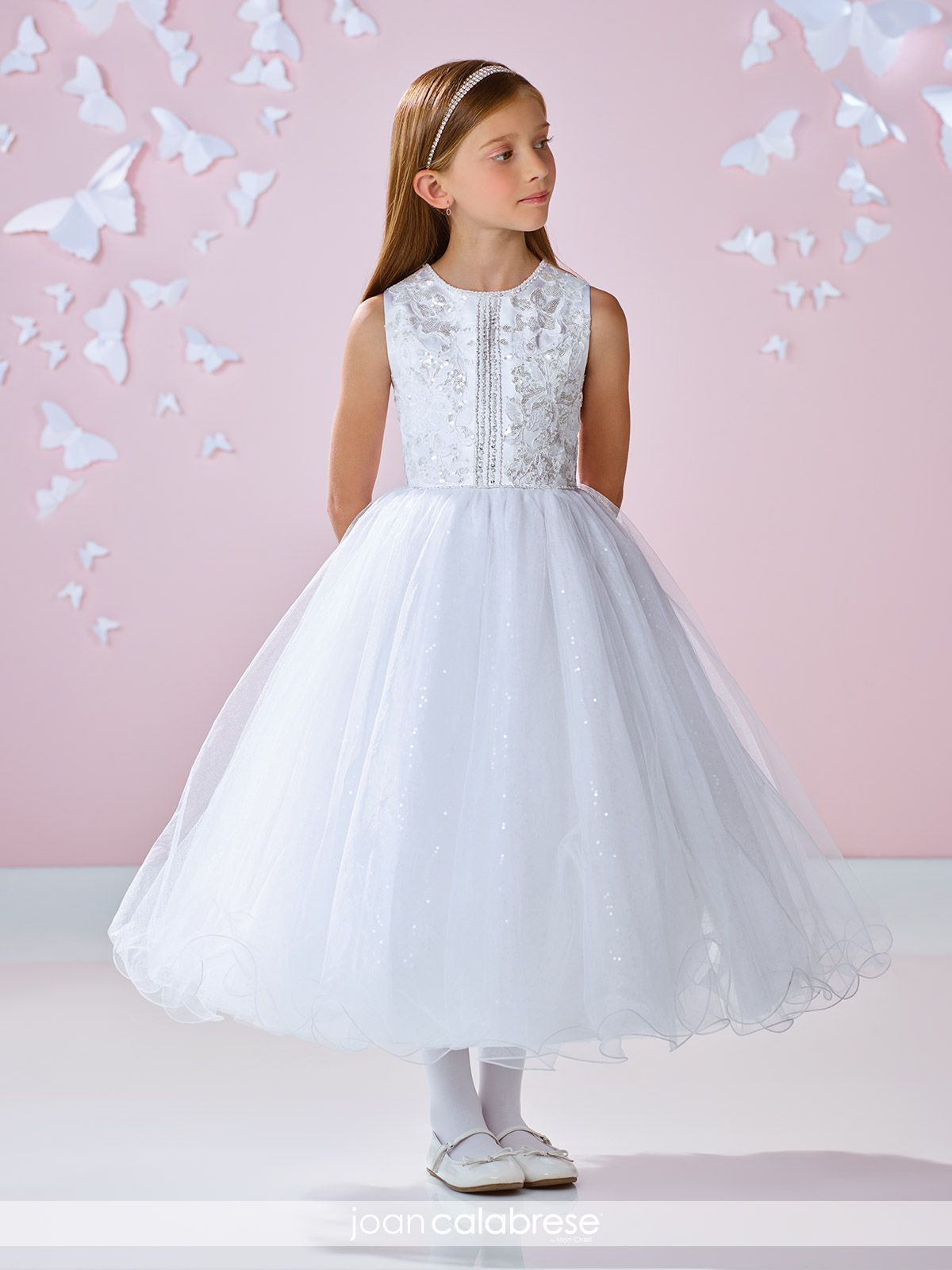 ce8f2b37f Sleeveless satin, tulle and lace tea-length full A-line dress with  hand-beaded jewel neckline, satin bodice trimmed with beading and beaded  lace appliqué, ...