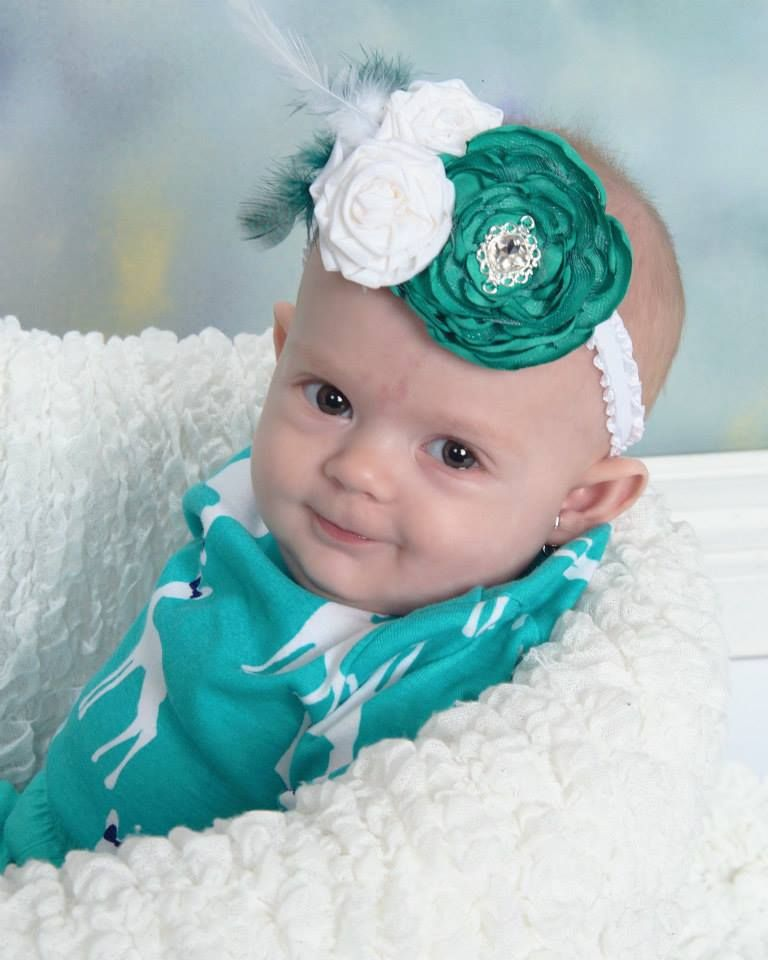 Handmade flower baby headband by Lindsay Armstrong Designs.