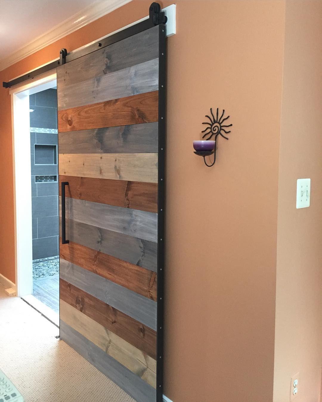 Our Multi Stain Horizontal Plank Barn Door Installed In A Master Door Installation Barn Door Design