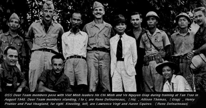 Tân Trào 1945 - OSS Deer Team members pose with Viet Minh leaders Ho Chi Minh and Vo Nguyen Giap during training at Tan Trao in August 1945. Deer Team members standing, l to r, are Rene Defourneaux, (Ho), Allison Thomas, (Giap), Henry Prunier and Paul Hoagland, far right. Kneeling, left, are Lawrence Vogt and Aaron Squires. (Rene Defourneaux)