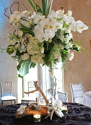 White Phaeo Orchids Tulips Hydrangea Calla Lilies Dendrobium Orchids And Roses Monstera Leave Floral Arrangements Flower Arrangements Wedding Centerpieces