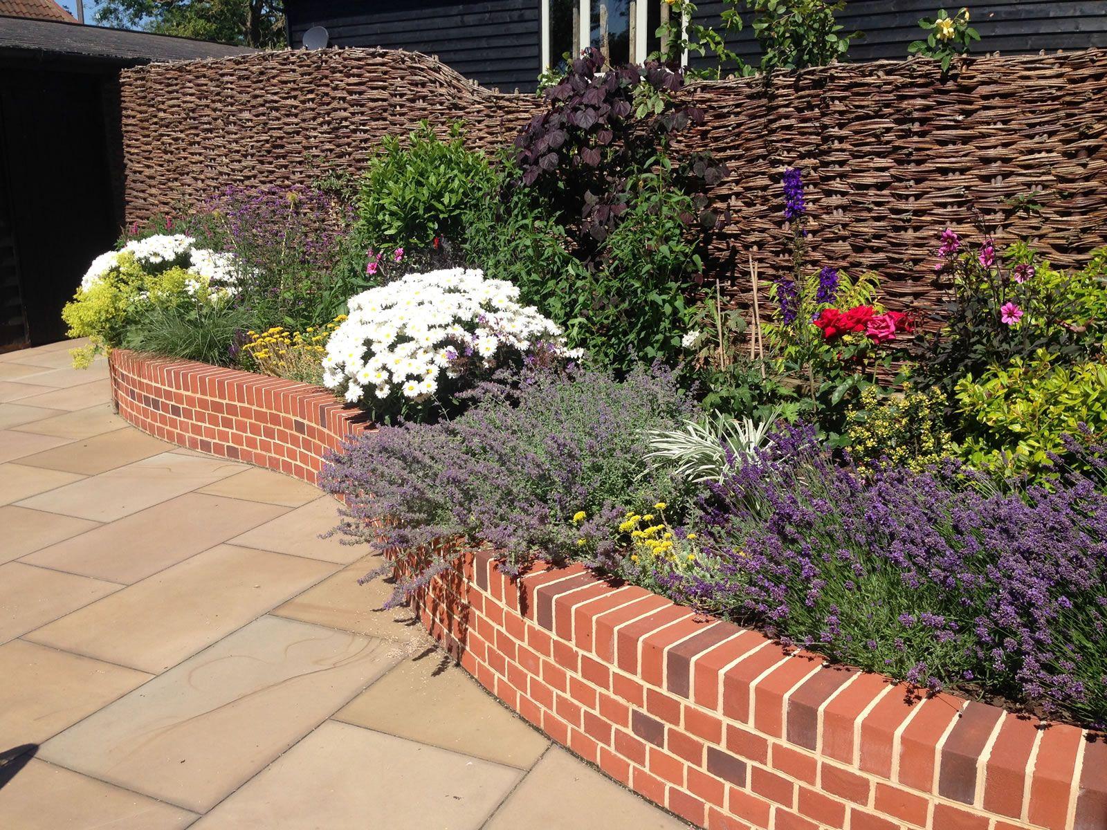 Brickwork and Flint panel | Brick garden edging, Courtyard ...