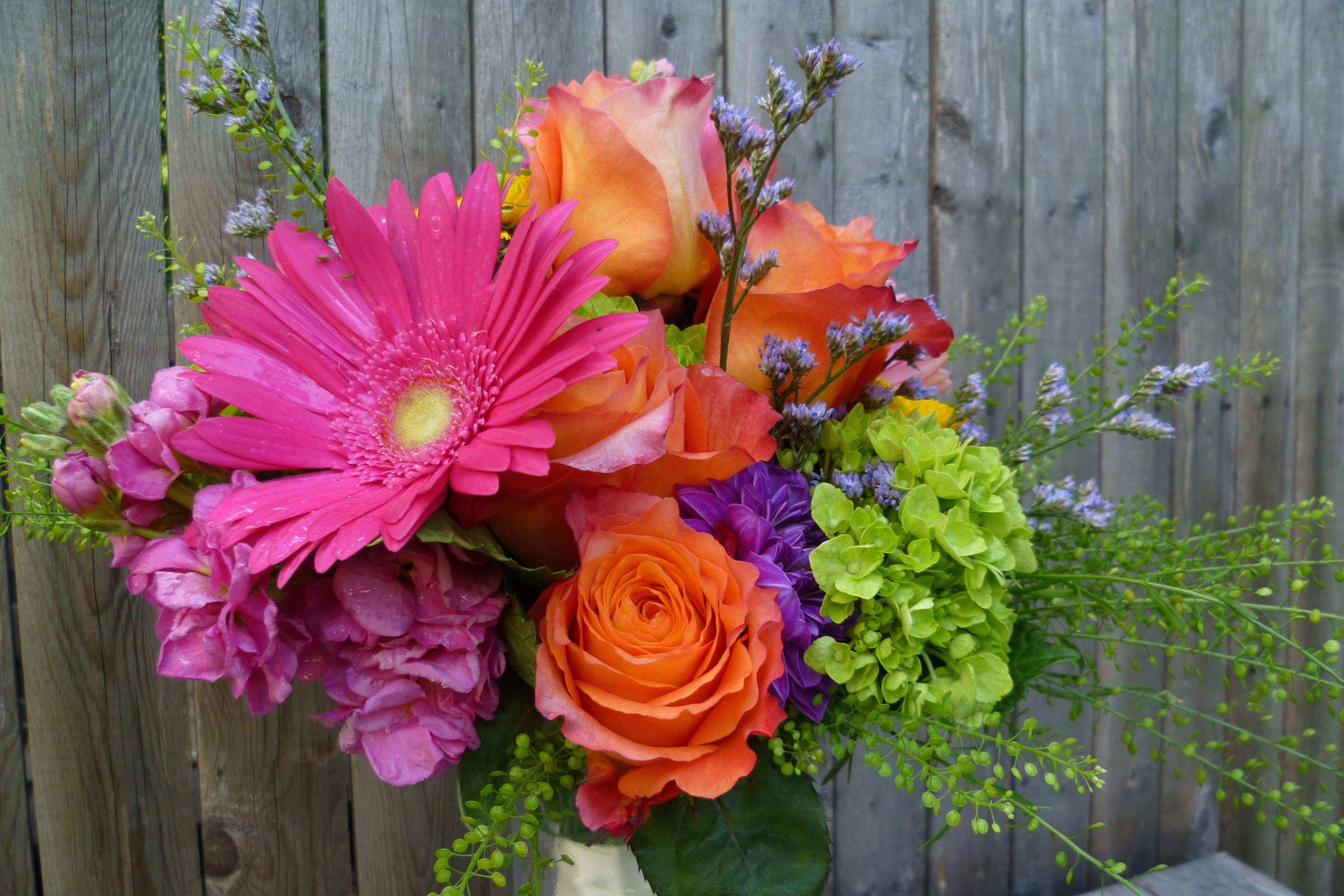 Summery, bright bridal bouquet feauring hot pink gerbera