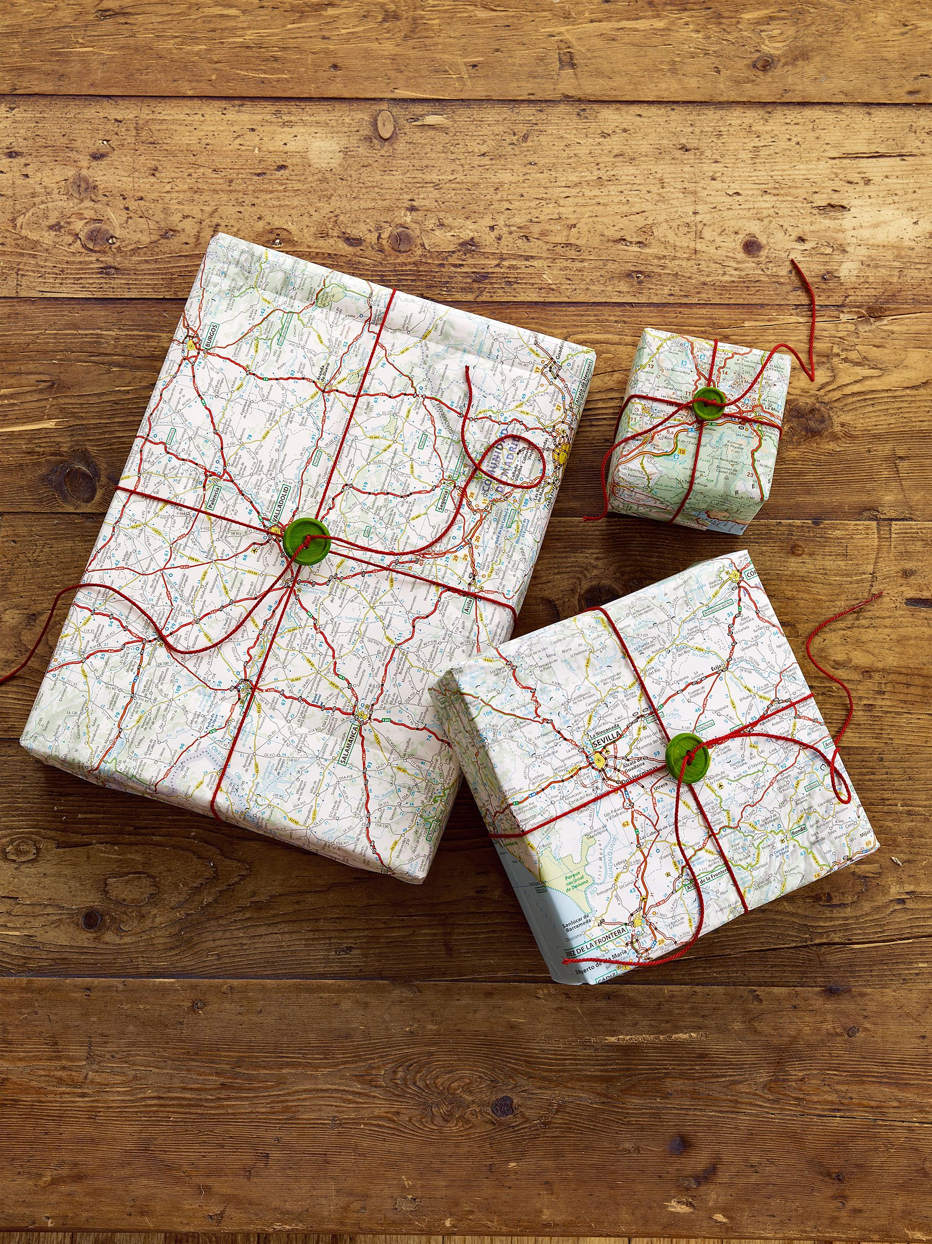 30 Holiday Craft Projects For a Very Merry Christmas   Cord  Wraps     This Christmas  wrap gifts with Road Map Gift Wrap  Instead of tying a bow  on top  thread thin cord through a vintage button and knot tightly to  secure