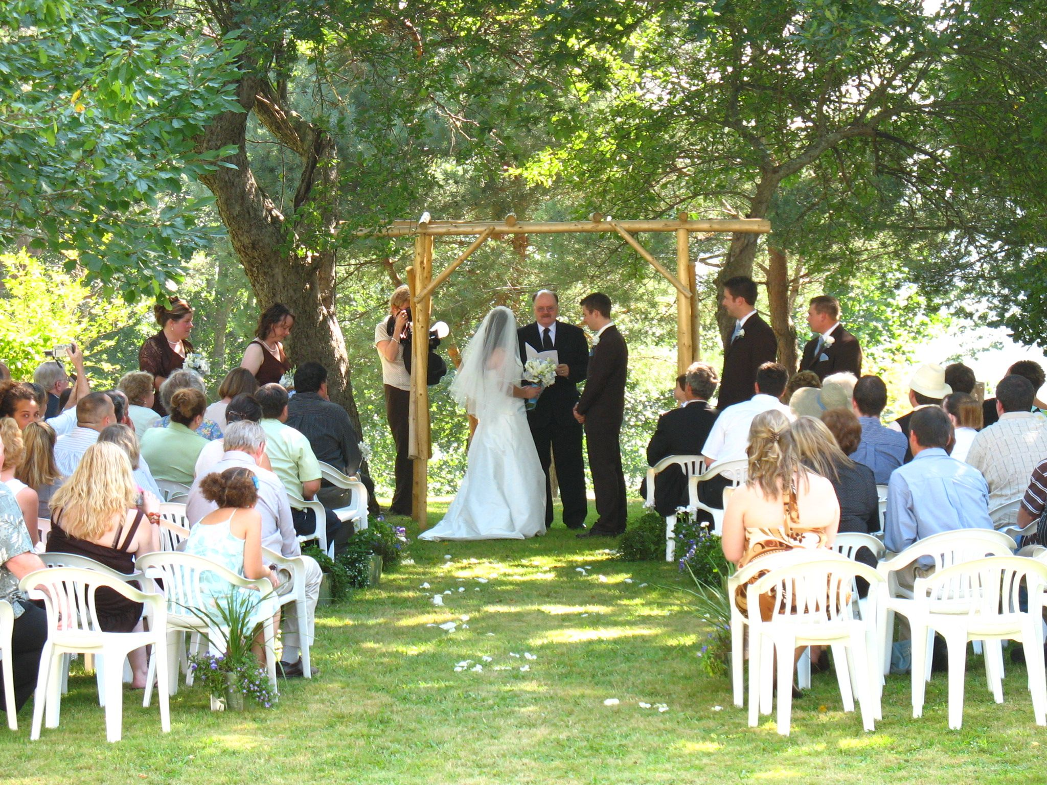 Wedding Ceremony Under The Shade Of Apple Trees On Grounds