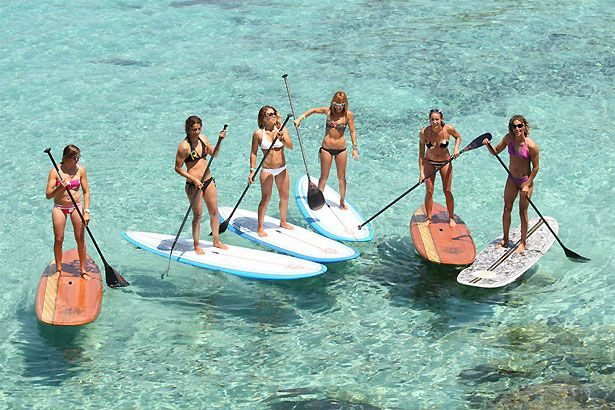 Surfer girls turned into paddleboard girls.  This will be me in a couple of.years once we get to Hawaii.