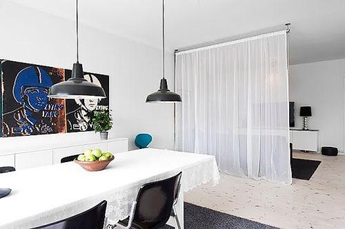 cortinas como separador de ambientes en un comedor