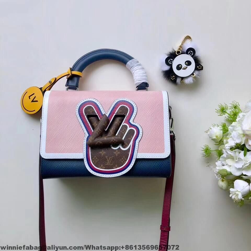 3e65257af943 Louis Vuitton Peace Symbol Lock Epi Leather Twist MM Bag M52514 2019 ...