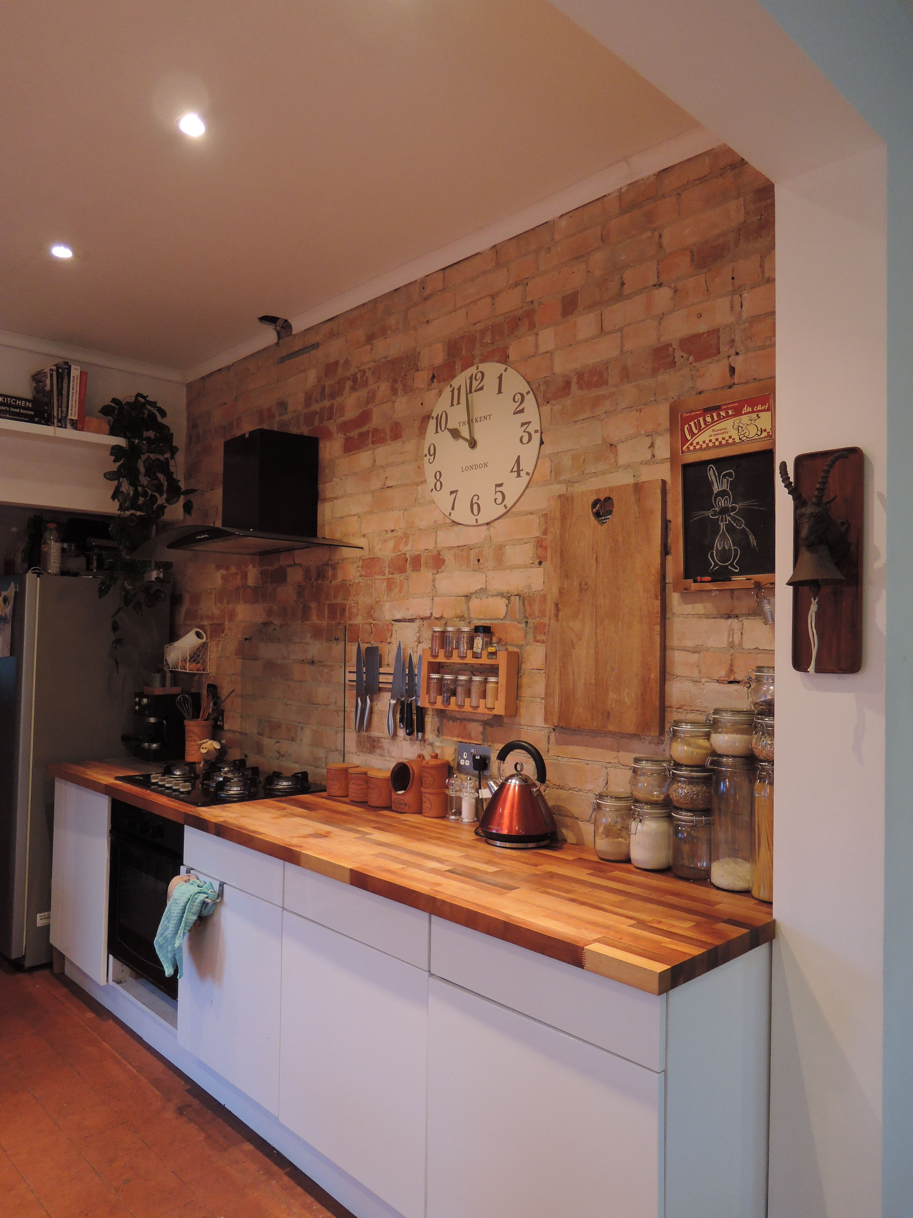 Large thomas kent clock on exposed brick wall classic french large thomas kent clock on exposed brick wall classic french restaurant chalkboard goat bell amipublicfo Image collections
