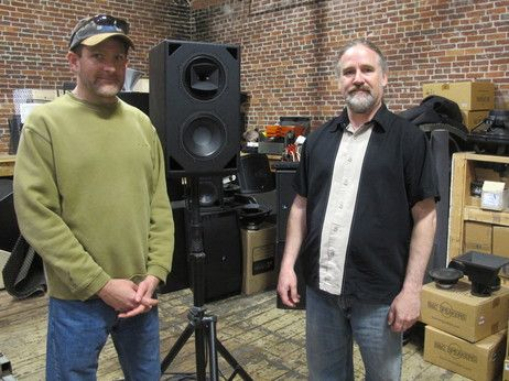 Fulcrum Acoustic engineer Rich Frembes (left) and founder Dave Gunness pose in their workshop. The company produces more than 2,000 speakers a year, often testing and tweaking the units obsessively to meet each client's specific needs.
