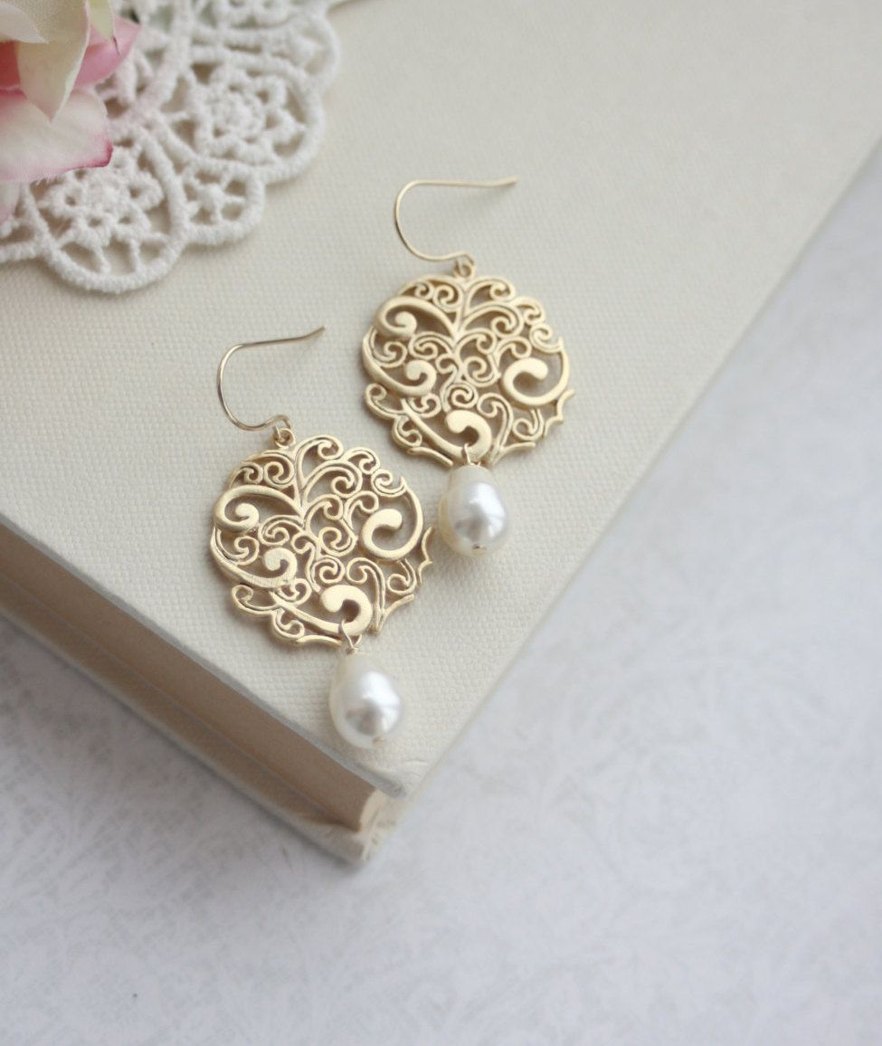 ♥´¨) ¸.•´ ¸.•*´¨) (¸.•´ ♥ ~ Gorgeous matte gold filigree beautiful intricate and details all around. It is suspended with ivory swarovski pearls swaying beneath. They hang from tarnish resistant, gold plated over brass french ear wires. Lovely for your wedding day or everyday earrings for yourself or someone special. I also have these earrings with pink opal glass stones as seen in the last photo :)  Filigree measures approximately 1 inch in diameter. Length of the earrings are close to 2…