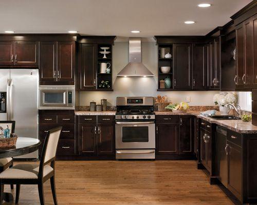 Dark Cherry Kitchen Cabinets This kitchen looks so elegant and modern, black cherry cabinets
