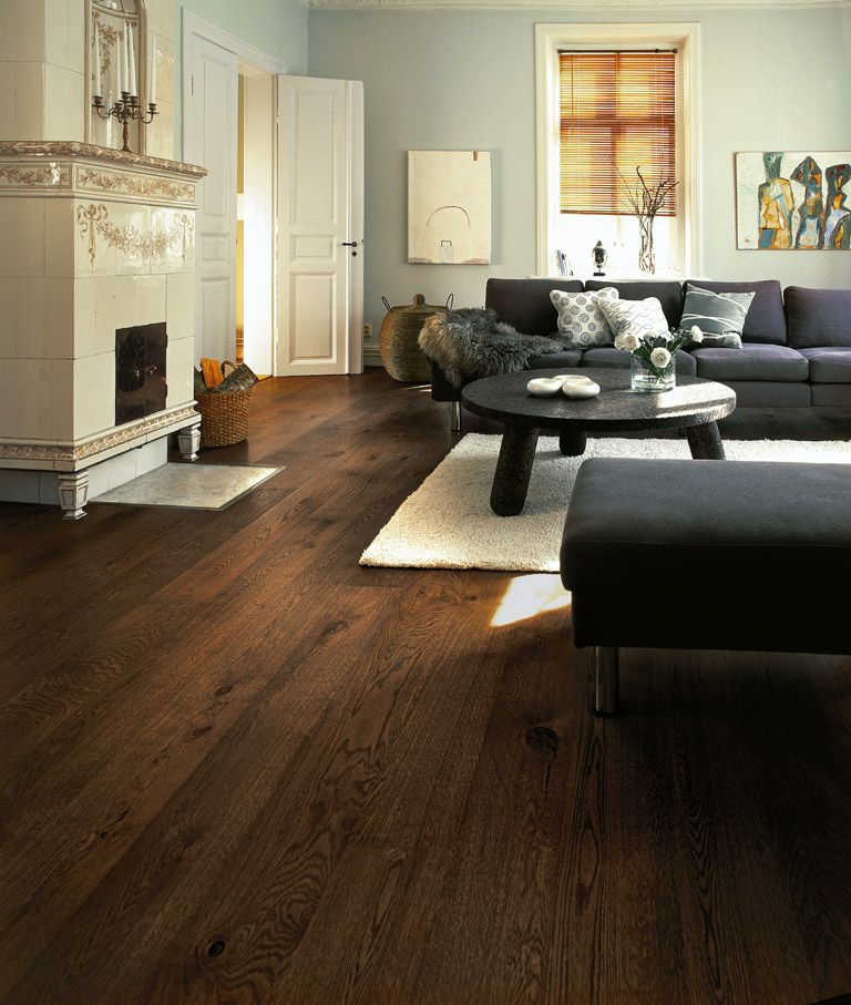 Dark floor with dark furniture maybe something like this for Living room designs with dark hardwood floors