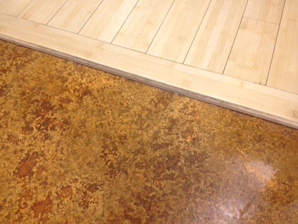 Threshold Of Stained Concrete And Hardwood Concrete Floors By Tmcc