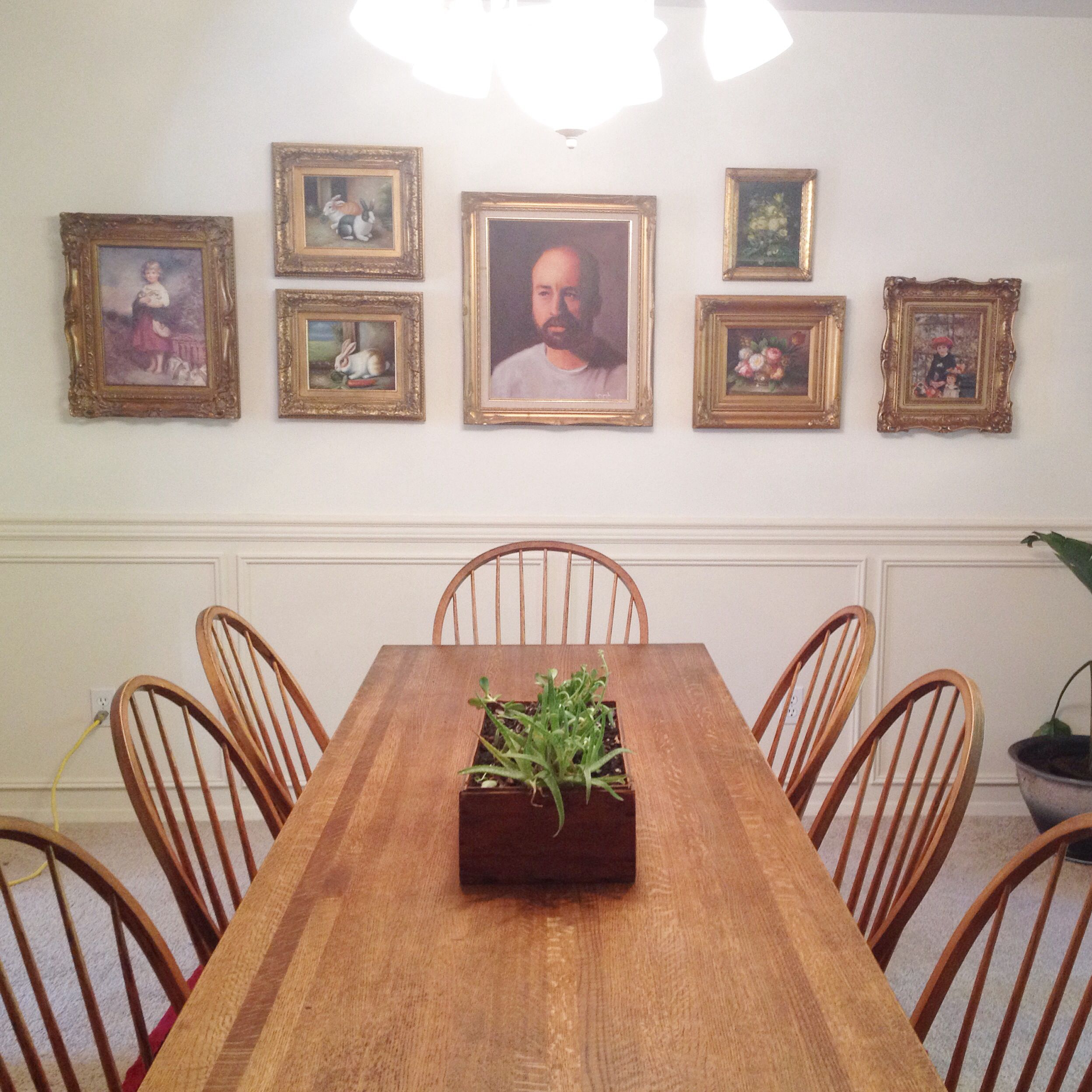 Dining room white walls gold gilt oil paintings gallery