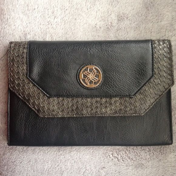Black Clutch Cute black clutch with a textured border. Clean on the inside. Bags Clutches & Wristlets