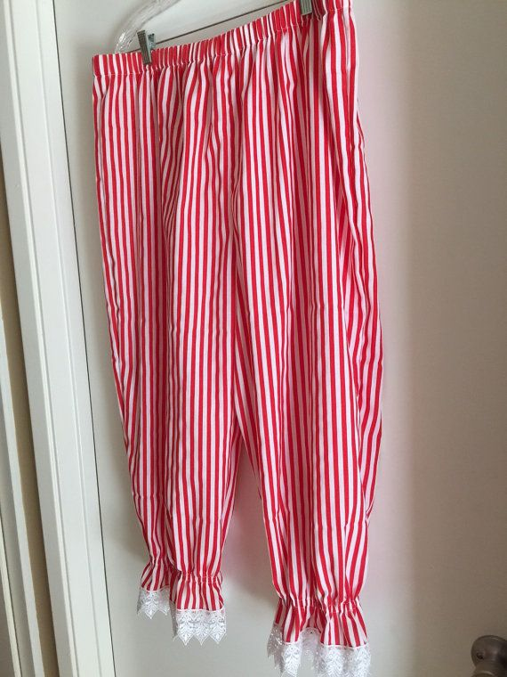 Avoid the chafe and burn with these comfy bloomers, perfect for Pirate Faires, SCA events and Renaissance Faires. Made from red and white striped cotton blend fabric. Has elastic waist and knee gathers. Bottoms have 2 ruffle with white Venice lace. Fits up to 44 waist and 50 hip. Unstretched waist 37; out seam 33 from waist to leg elastic with another 3-1/2 on ruffle for total length of 36-1/2. Machine wash cold, tumble dry low or hang dry.  After they were completely finished, I discovered…