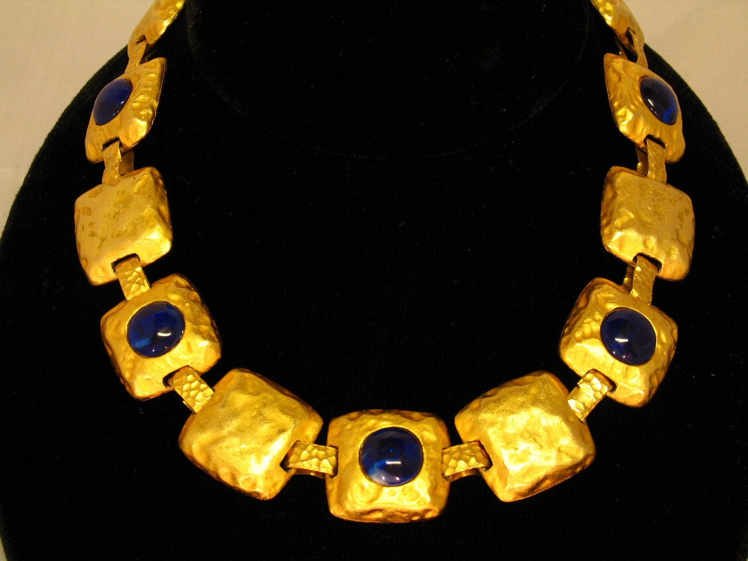 Les Bernard Necklace Choker Gold Tone Rustic, Hammered Look w Emerald Blue Cabachons Ca. 1970s WAS 120. $ 95.00, via Etsy.