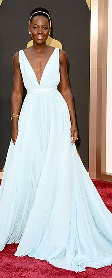 Lupita Nyong'o shuts it down in a light blue Prada gown and Fred Leighton jewels at the 2014 Oscars