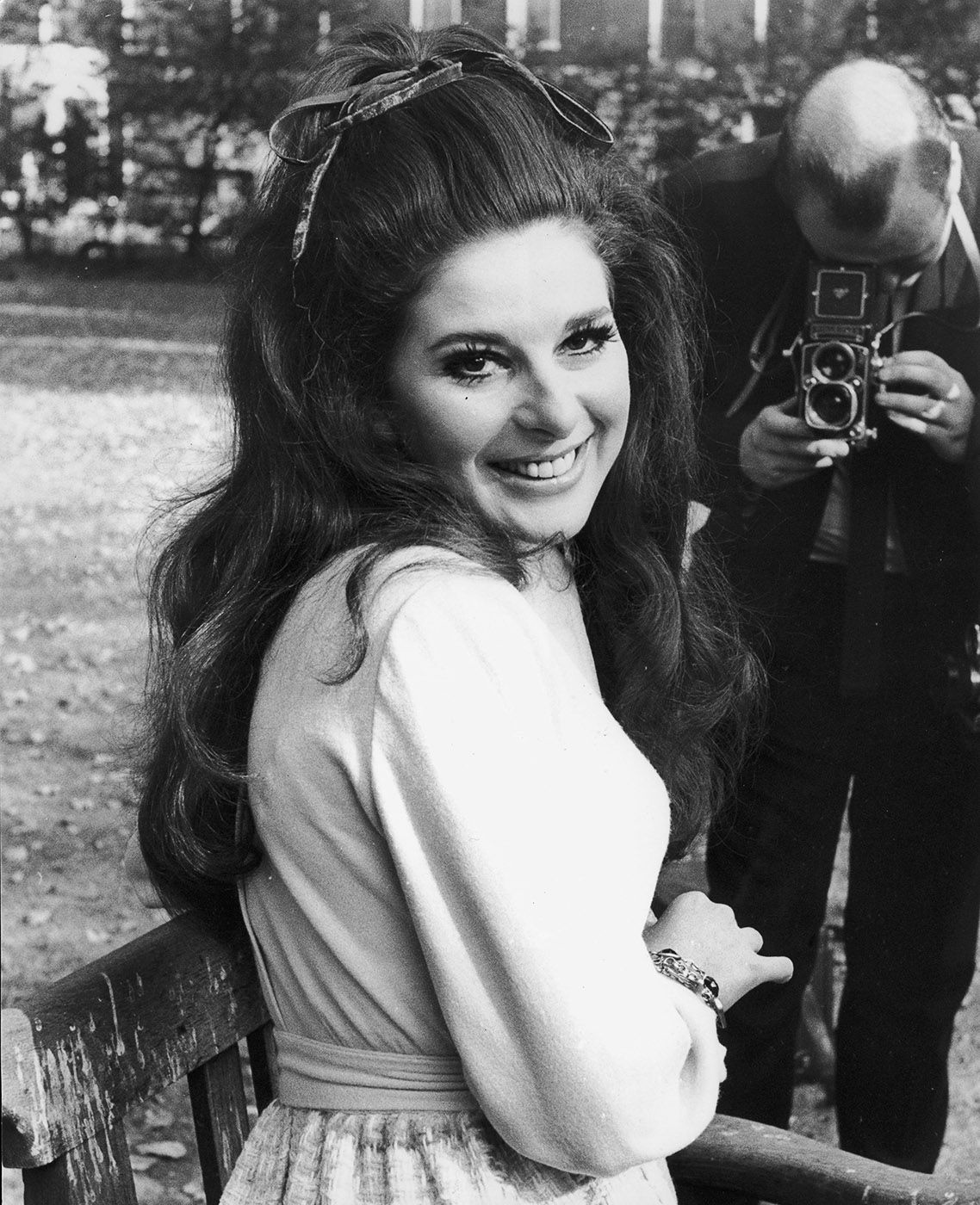 1969 | American country singer Bobbie Gentry poses for a photographer during a visit to London with high hair and a bright smile. via @stylelist