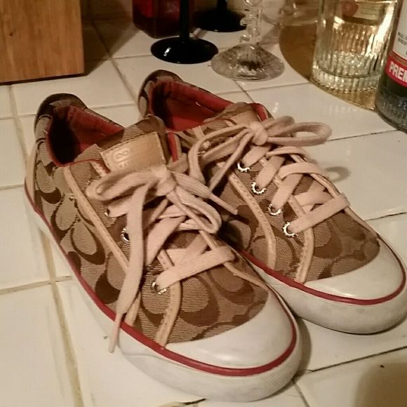 Coach tennis shoes trade $65 Authentic Coach Shoes tan and dark tan canvas material tan rubber sole very good condition just dirty on the bottom due to walking used several times the second pair almost the same as the first there's no shoelaces they been used but in good condition size six and a half let me know if you like them Thank You Mona coach Shoes Athletic Shoes