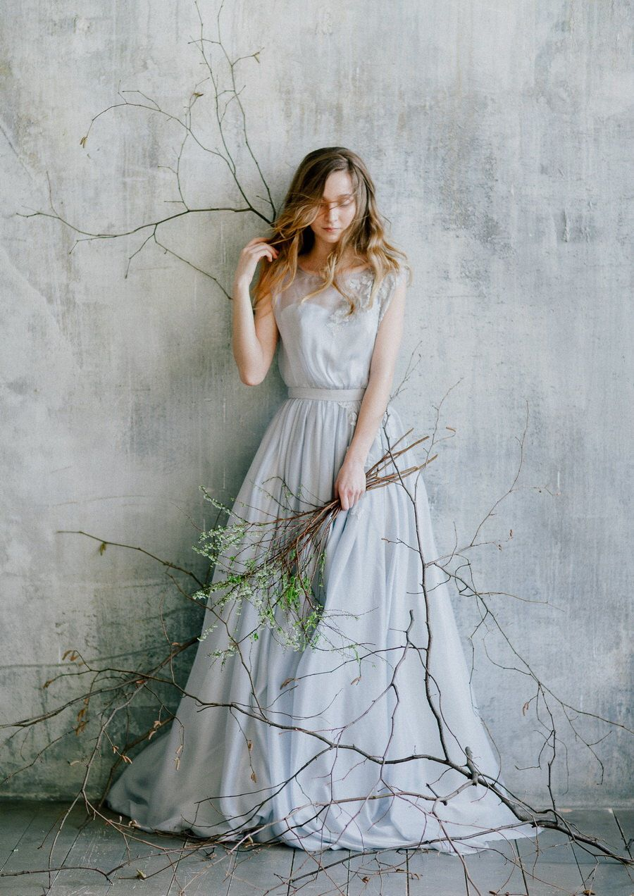 Flowing blue grey wedding dress with floral lace decoration ...