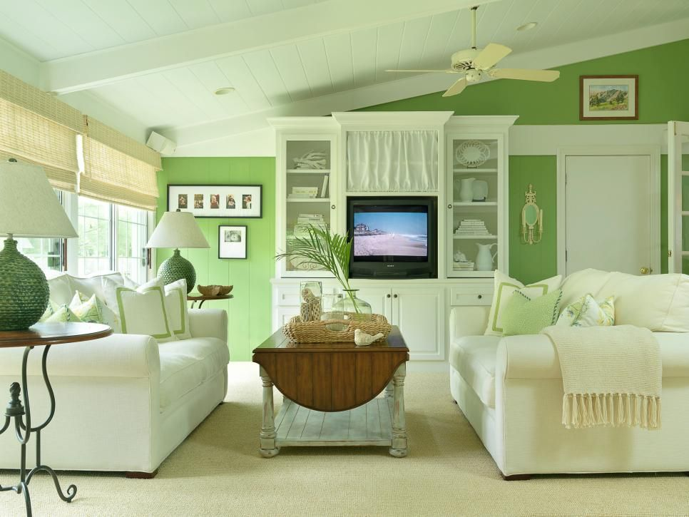 Light Green Walls And White Furniture Keep This Living Room Mesmerizing Light Colored Living Rooms Decorating Design