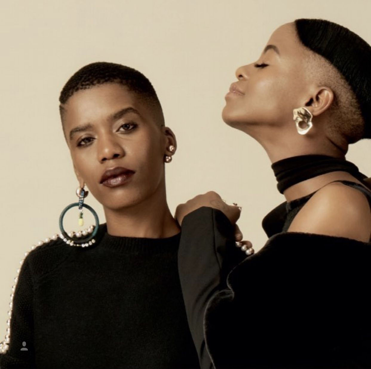 Model on the right wearing pichulik abalone earrings with
