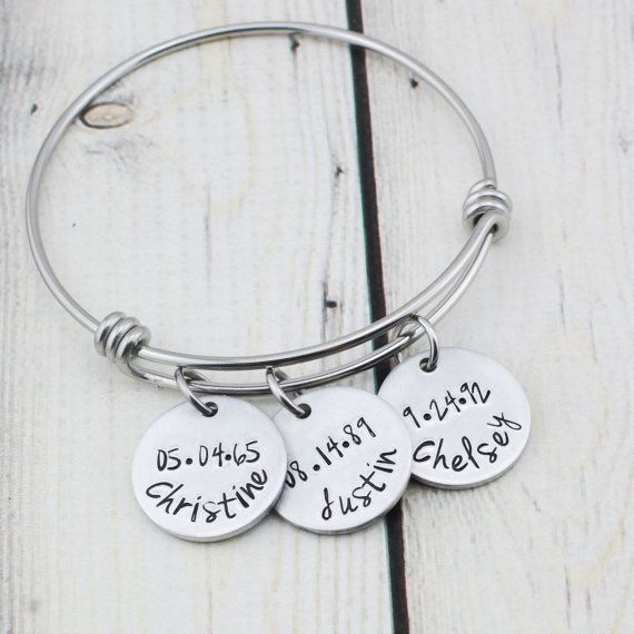 This personalized mom bangle bracelet hand stamped with names and birthdates would make a great gift for a mom or grandmother.  SPECIFICATION: The bangle is adjustable and made of solid stainless steel. It is a medium size but fits most wrists. The name charms are 3/4 non-allergenic aluminum. Neither the bangle or name charms will rust or tarnish. Each name charm will be hand stamped by me with the name of your choice and birth date. The name discs will have a smooth, satin finish. You c...