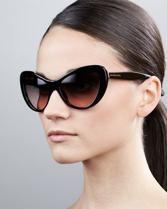 aa1f9427a901 Rounded Cat-Eye Sunglasses by Miu Miu at Neiman Marcus.  280