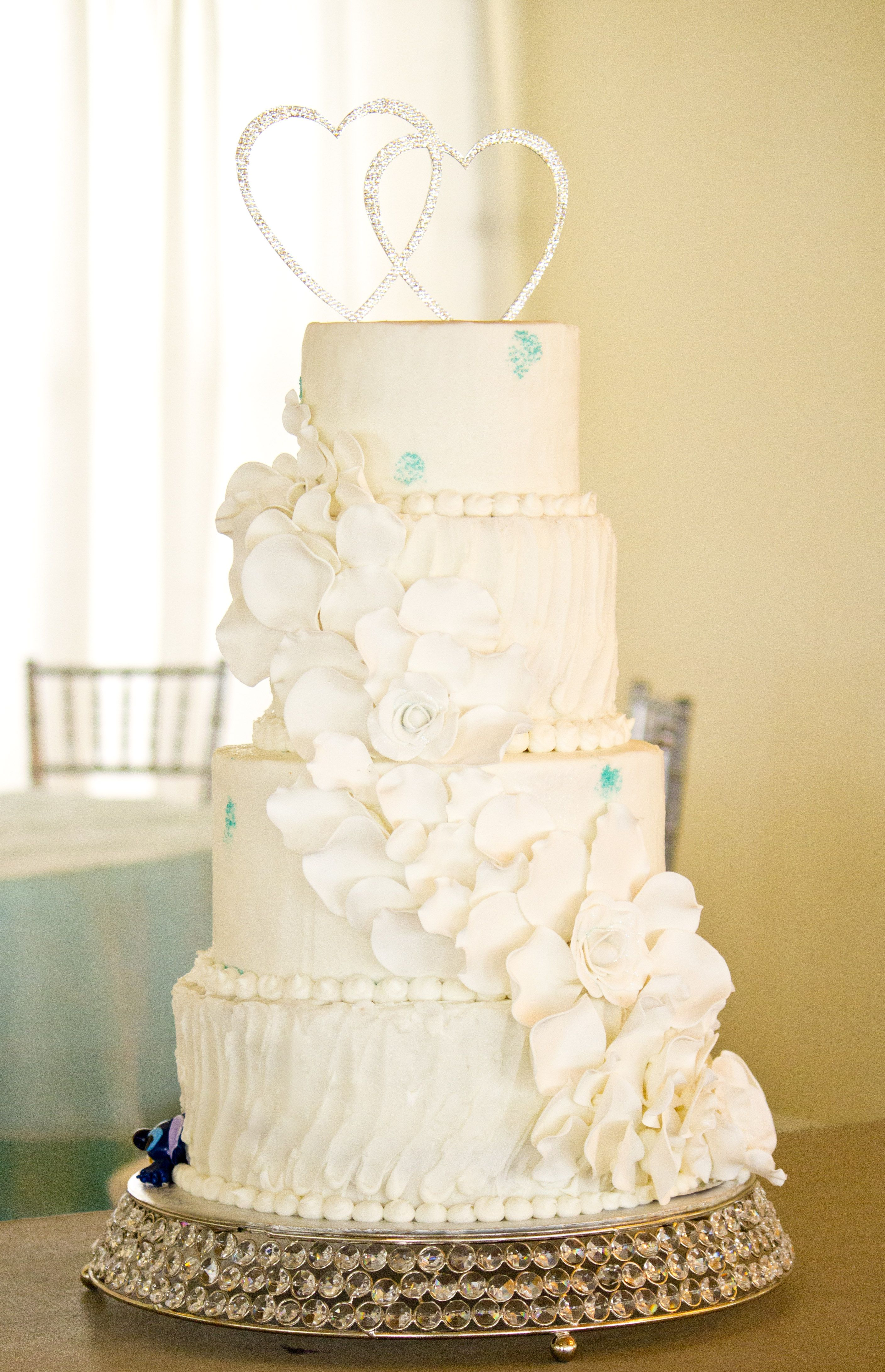 4 tier buttercream cake, with cascade of fondant flowers and ...
