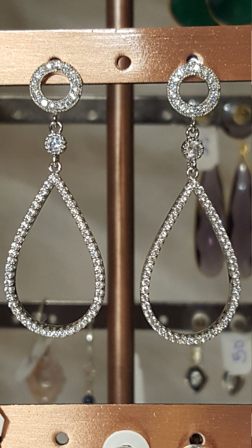 Silver and CZ teardrop dangling earrings by MDEBRJewelryDesigns on Etsy
