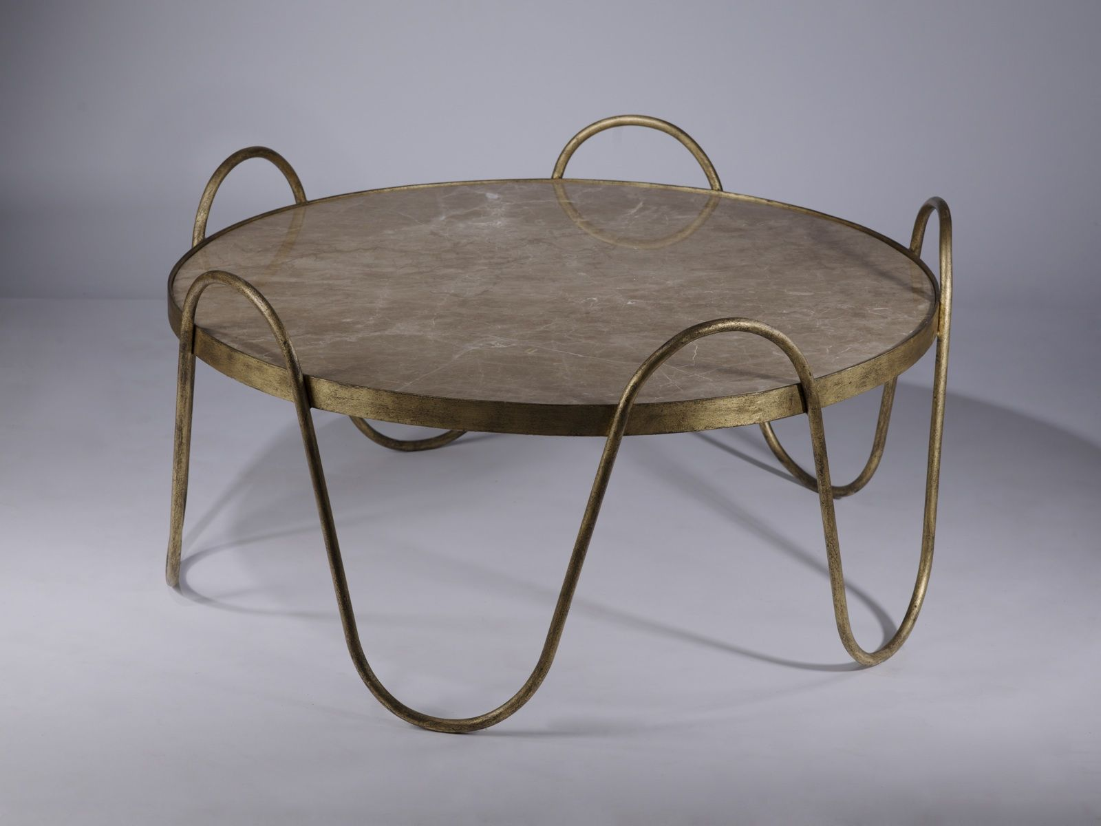 wrought iron drum coffee table in distressed gold leaf finish