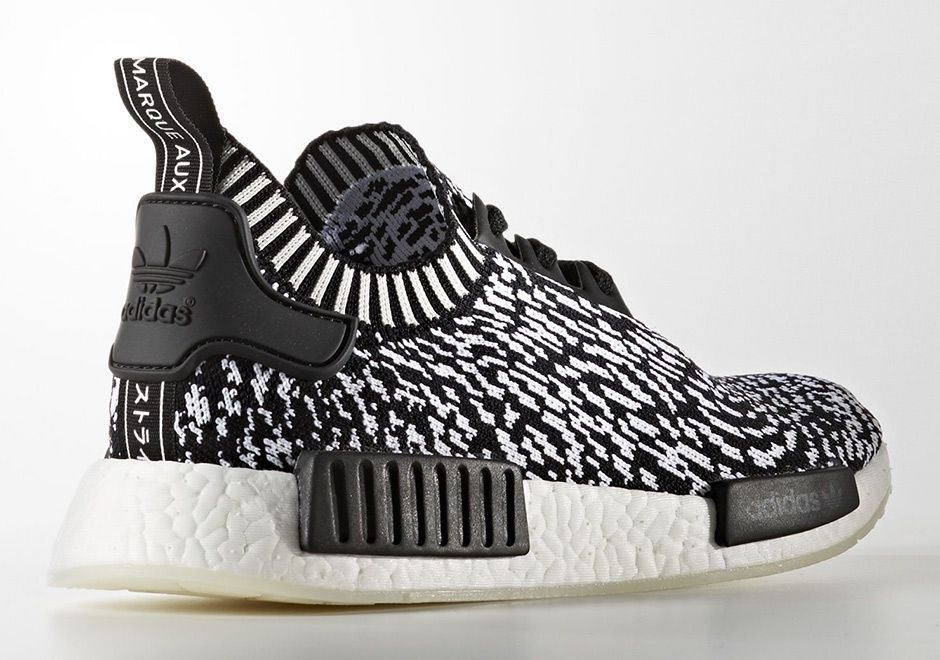 "a616fdc0de97c The adidas NMD gets more than three stripes with this upcoming ""Zebra"" pack  featuring two wild options. Perhaps inspired by the popularity of the  ""Zebra"" ..."