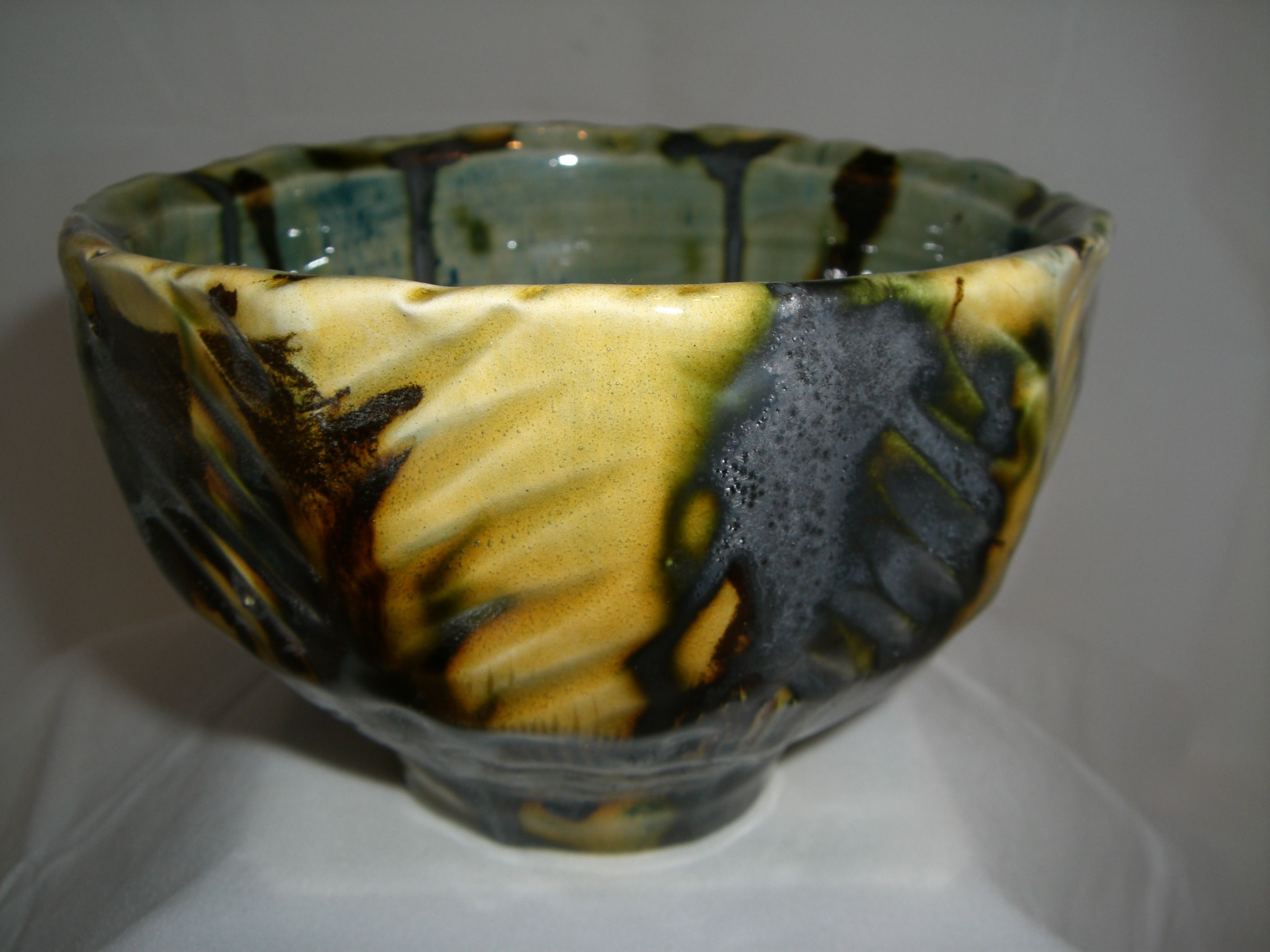 Tea bowl. Earthenware. Incised / altered.