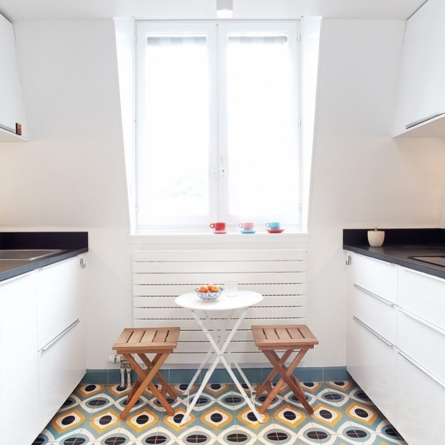 Colourful kitchen floor with goose eye cemen tile pattern from
