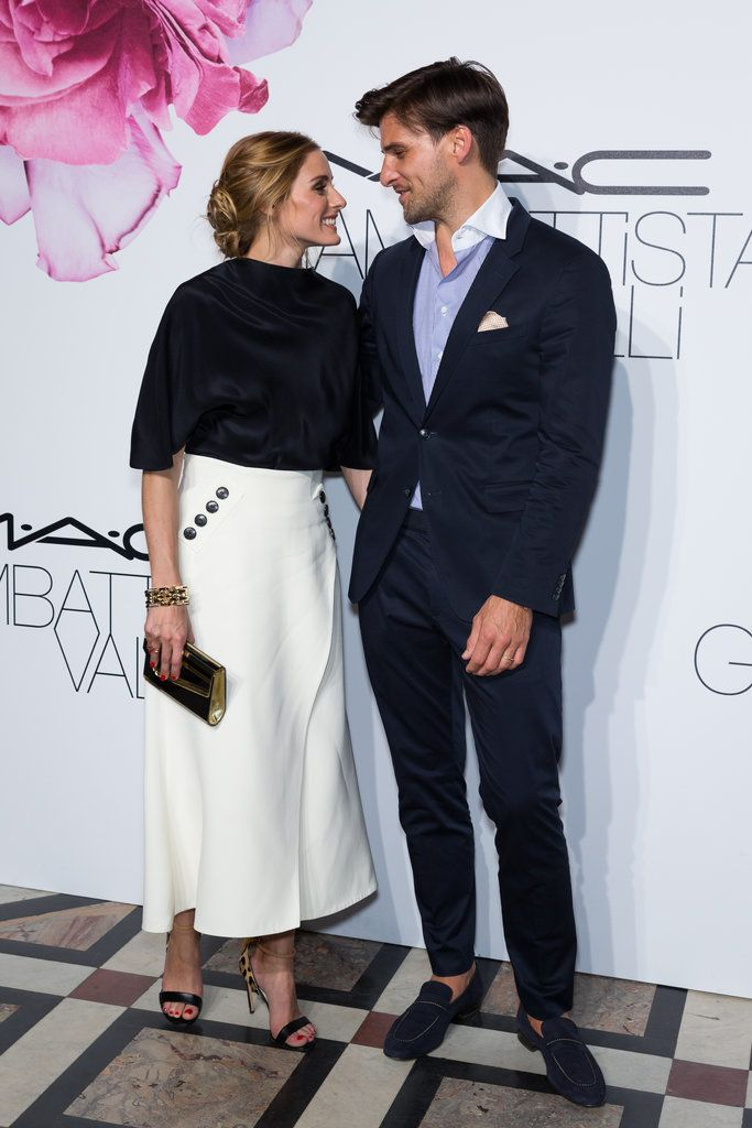 Olivia Palermo shares a tender moment with her husband while looking polished and elegant in her white skirt and leopard heels.