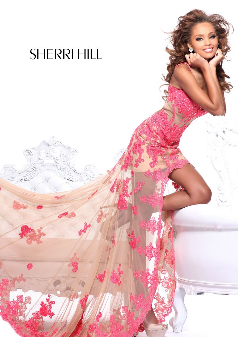 The dress provides the dominant color and form while model poses ...