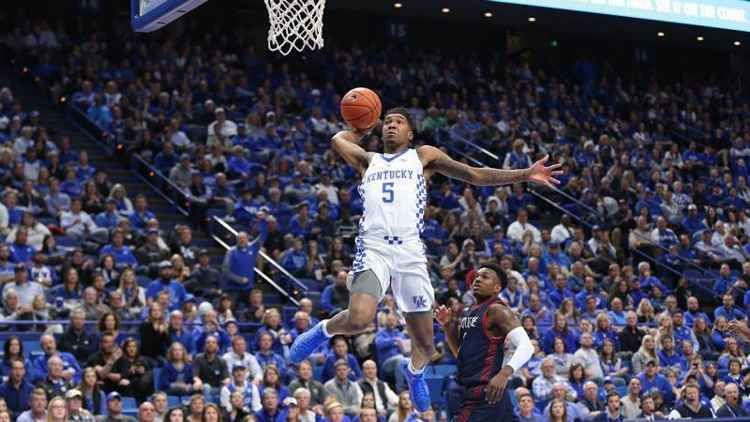 Kentucky moves into the No. 1 spot in The Associated Press college basketball poll, replacing Duke, which dropped to sixth following its final-seconds loss to Kansas in the Champions Classic.