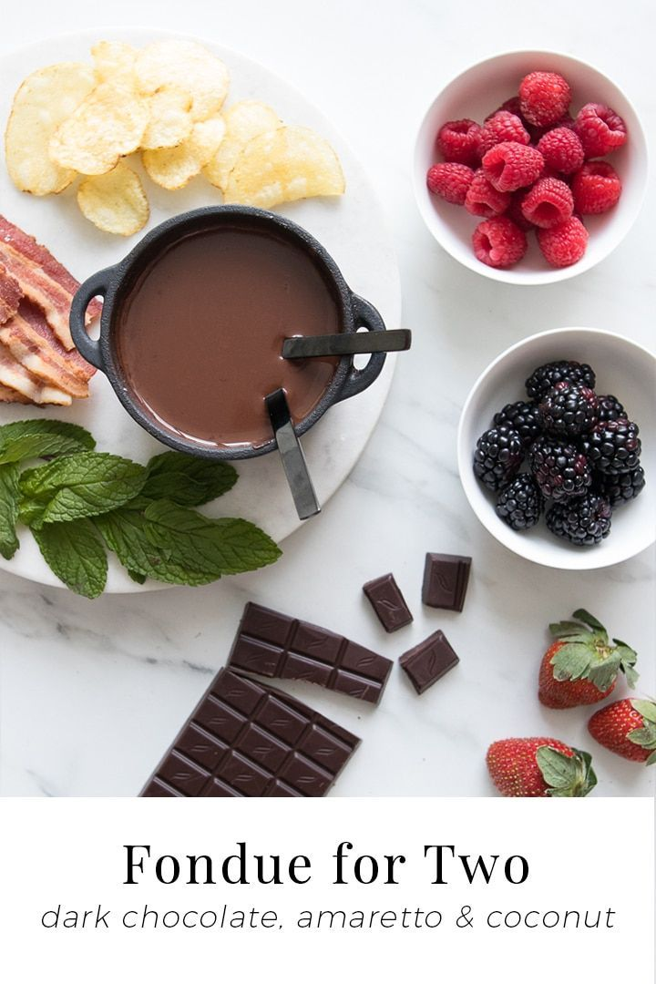 Dark Chocolate Fondue for Two #chocolatefonduerecipes Dark Chocolate Fondue for Two - Using rich dark chocolate, creamy coconut milk and a splash of almond liqueur, our Chocolate Fondue for Two recipe is silky, decadent, and perfect for dipping fun and fresh ingredients while igniting all the senses. #chocolate #fondue #dessert #Valentines #chefsouschef #chocolatefonduerecipes