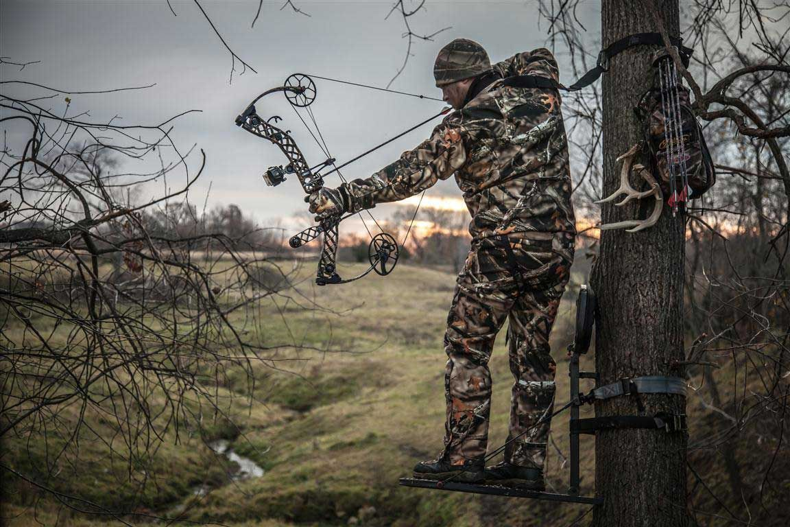 Bow hunter showing proper bow form in treestand.