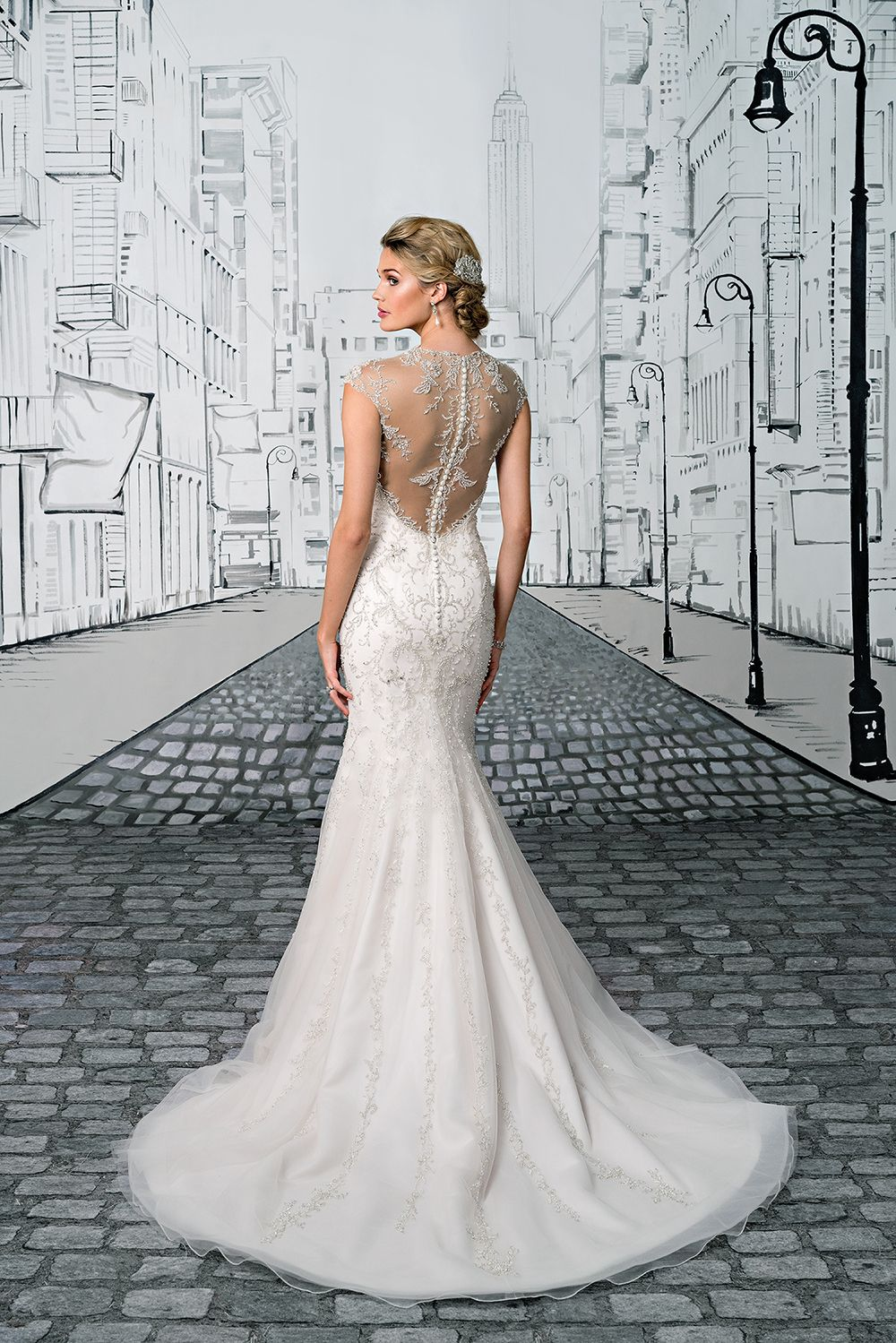 ff798f2959 Exude modern glamour in this fit and flare gown with a Queen Anne neckline