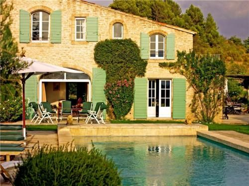 Stone Mas in France with pool, probably in Provence - love the shutters