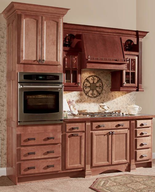 spiceberry colored cabinets with cook top  see more in our kitchen cabinet gallery  arlington arch maple nutmeg java and arlington square oak sable      rh   pinterest com