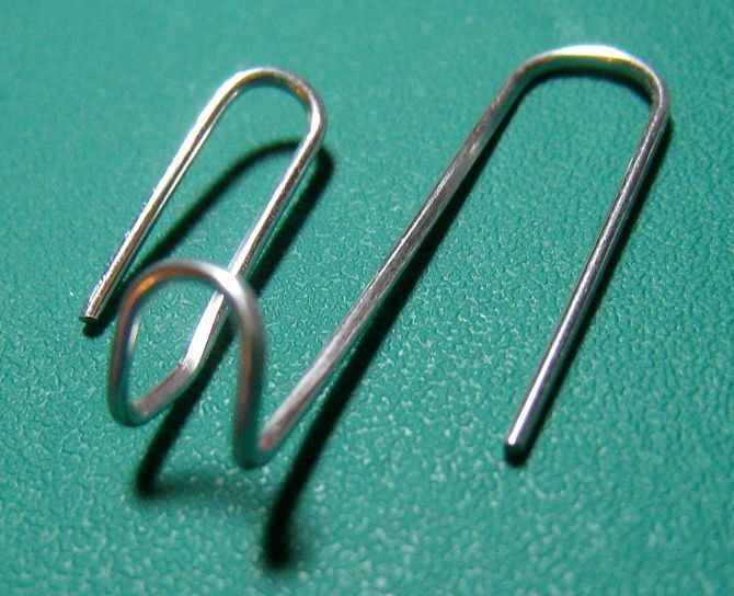 Bend A Paper Clip To Hang Light Objects On Cubicle Walls