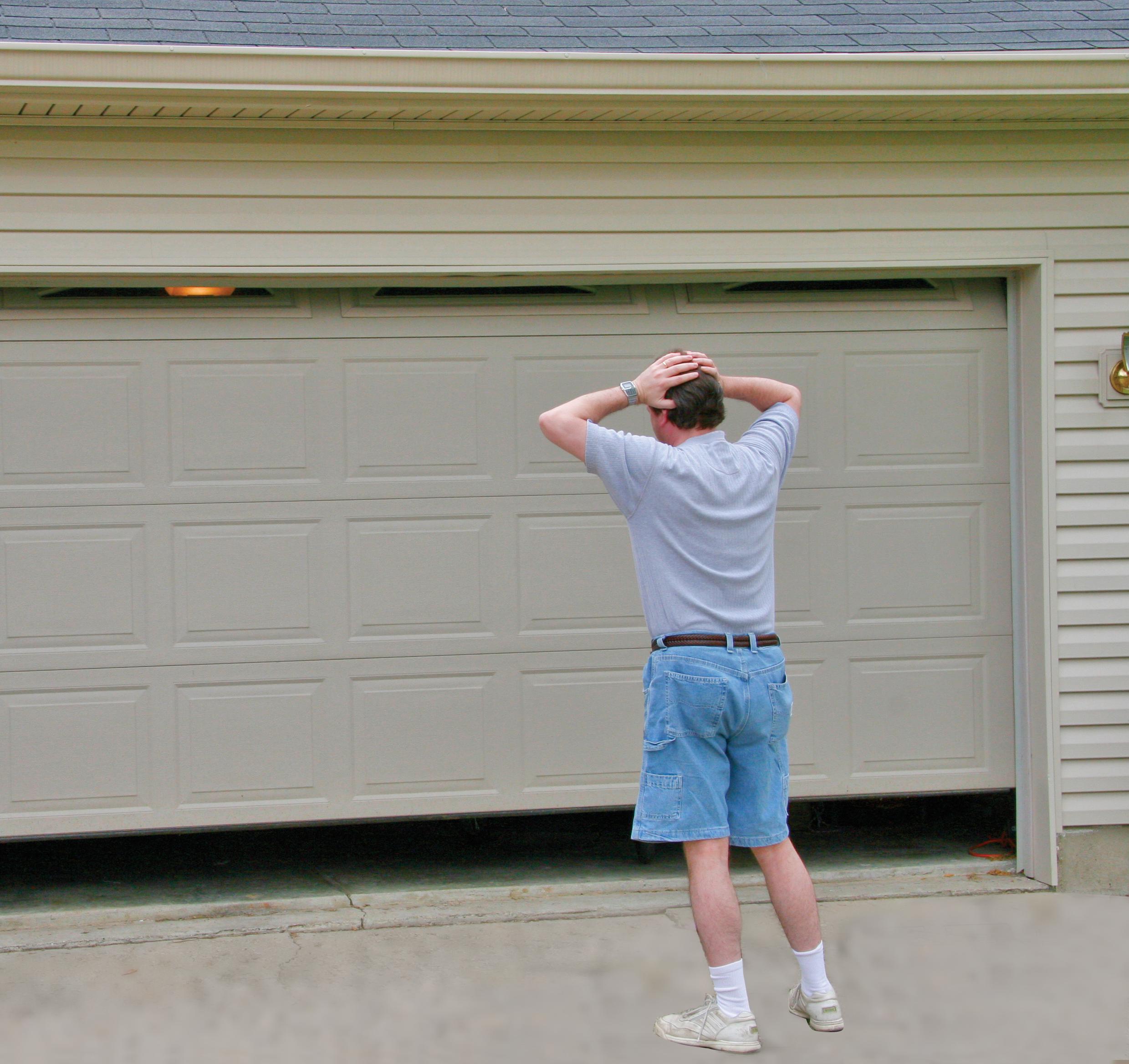 Why Is My Garage Door Opening By Itself Garage Door Maintenance