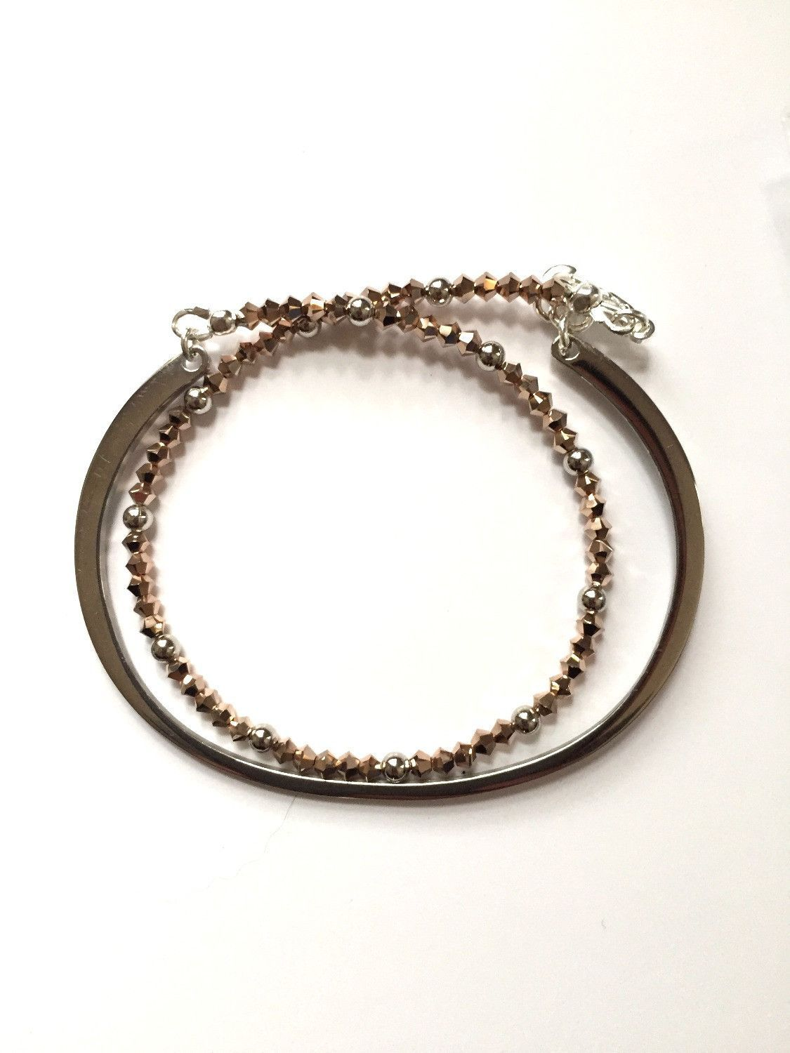 Stainless steel and rose gold swarovski crystals bracelet products