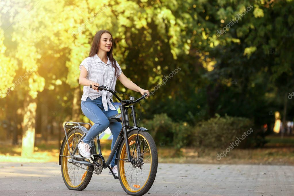 Young Woman Riding Bicycle Outdoors Stock Photo Spon Riding