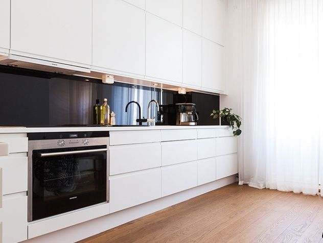 white kitchen and black splash
