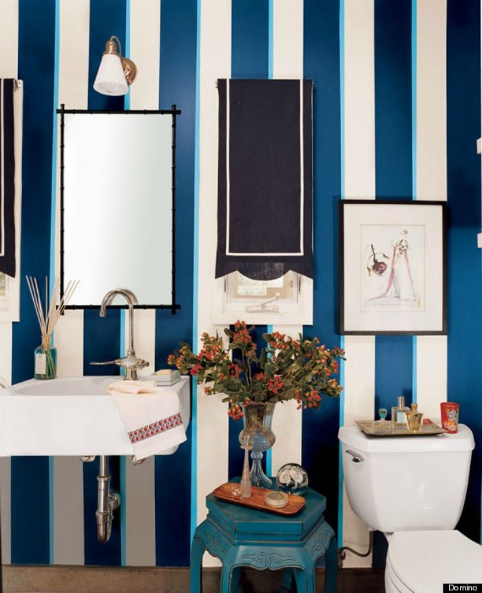 navy blue and white vertical striped wallpaper in bathroom